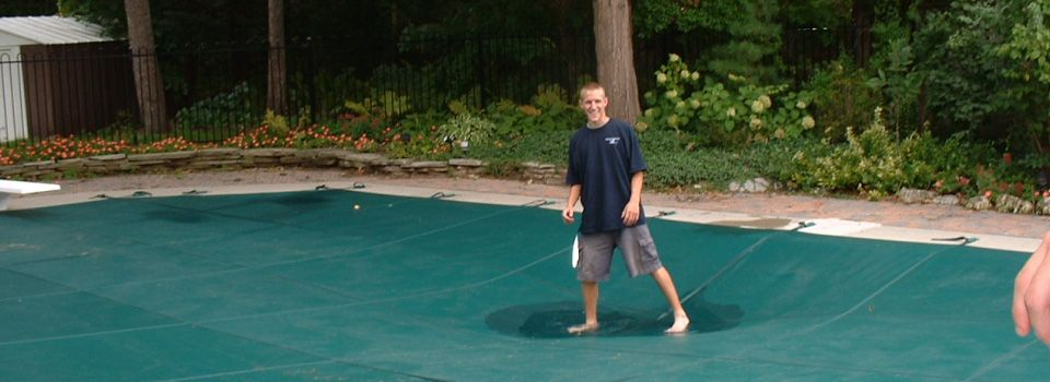 Kid Bouncing on Pool Cover